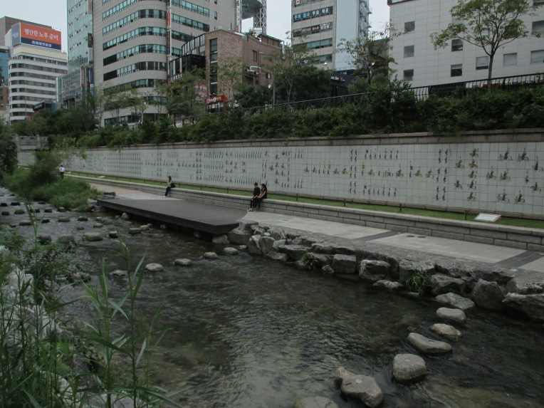 Cheonggyecheon (청계천) restoration project initiated by Lee Myung-bak in 2003 (later the 10th President of South Korea) provides a much needed break from the traffic and heat.