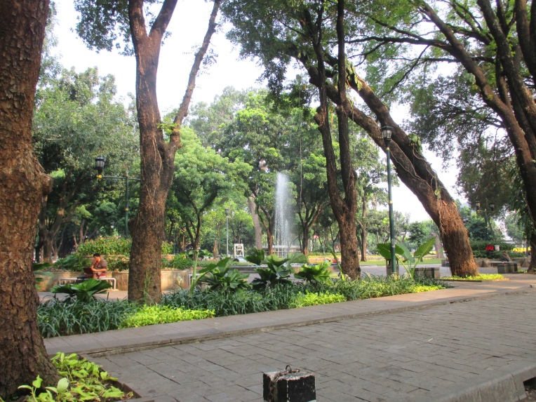 A park in an affluent area of Central Jakarta is well maintained and attractive, but the fumes and noise from adjacent streets make it hard to use.