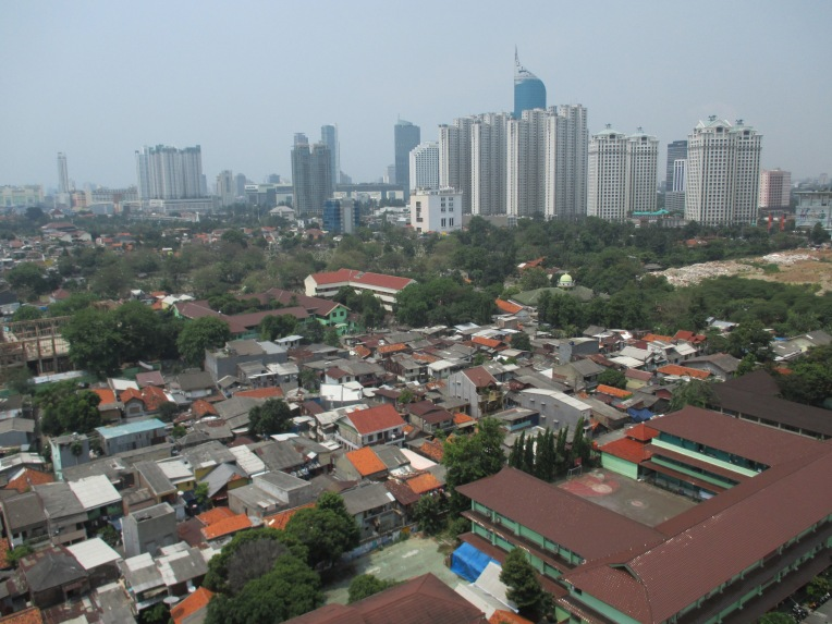 Jakarta's land use is based on organic growth. Old houses, high rises, cemeteries, malls, retails, school all jumped into the city to make more people commute.
