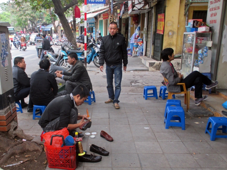 Sidewalks are promptly filled with informal workers providing services from shoe shine to motorcycle repairs.