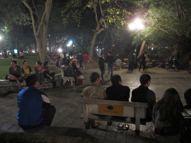 People of all ages gather at Hoàn Kiếm Lake for some Karaoke, a night stroll and a bite to eat.